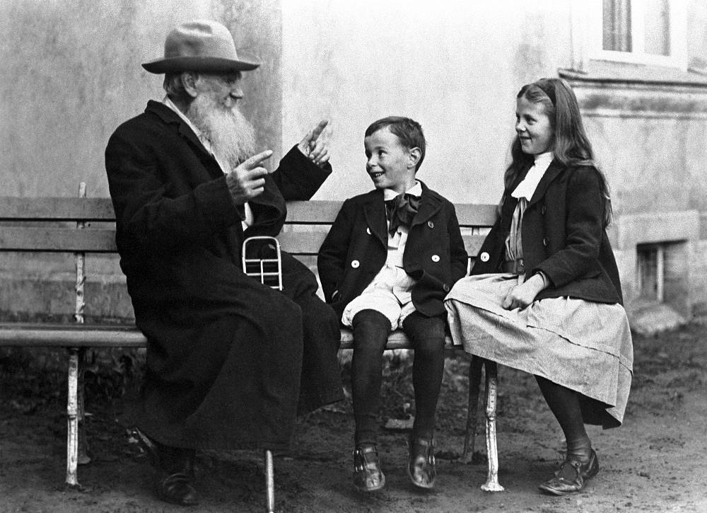 Writer Leo Tolstoi tells his grandchildren Sonya and Ilya a fairytale, 1909