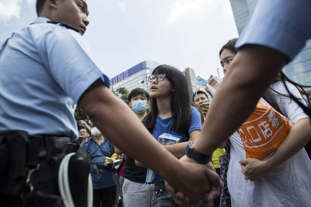 No special police units, which on Sunday used tear gas to disperse the crowds, are now seen on the streets. Police officers are trying to convince the pro-democracy protesters to leave the streets and key crossroads to allow emergency vehicles, public transport and other traffic to pass