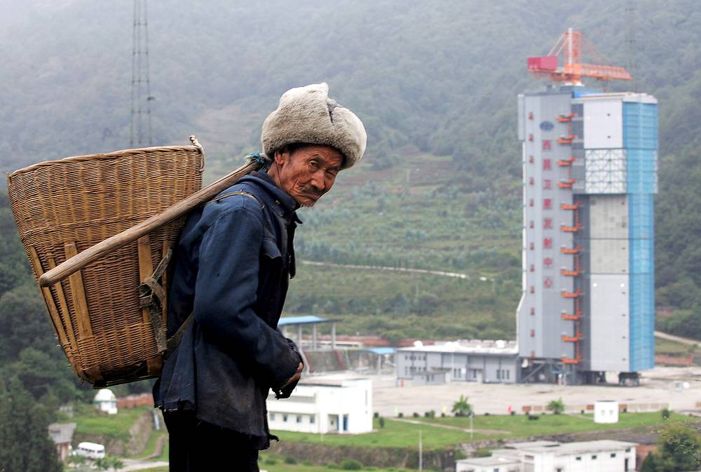 China's Xichang Satellite Launch Centre became operational in 1984. It is mainly used to launch powerful thrust rockets, geostationary communications, weather satellites as well as Chang'e moon rovers as part of China's lunar exploration program. Photo: A farmer walks on a hill by the Xichang Satellite Launch Centre in Xichang, southwest China's Sichuan province, October 21, 2007