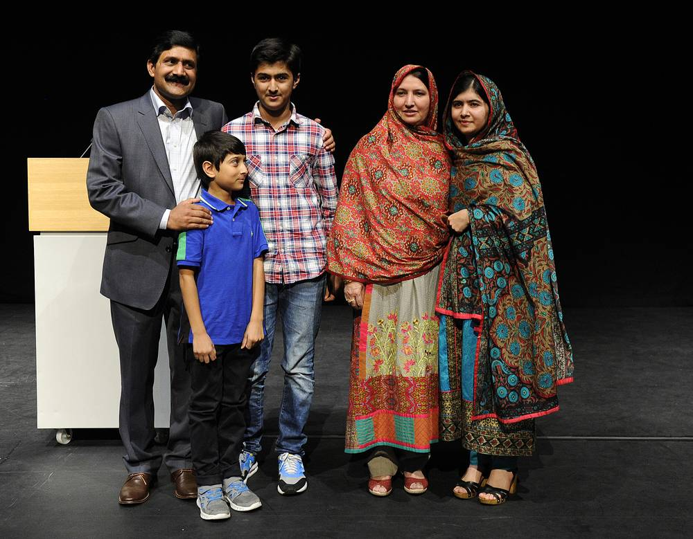Pakistani teenager Malala Yousafzai and Indian children's right campaigner Kailash Satyarthi won the 2014 Nobel Peace Prize. Photo: Malala Yousafzai of Pakistan poses with members of her family after delivering a statement after winning the Nobel Peace Prize in the Library of Birmingham in Birmingham in Britain, 10 October 2014