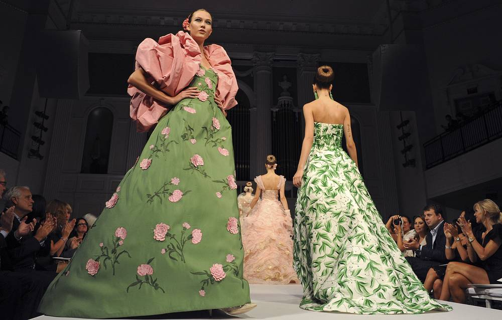 His specialty was evening gowns. Former first ladies Laura Bush and Hillary Rodham Clinton as well as celebrities from Penelope Cruz to Sarah Jessica Parker wore Oscar de la Renta creations. Photo: The finale of the Oscar de la Renta spring 2011 collection, New York, September 16, 2010