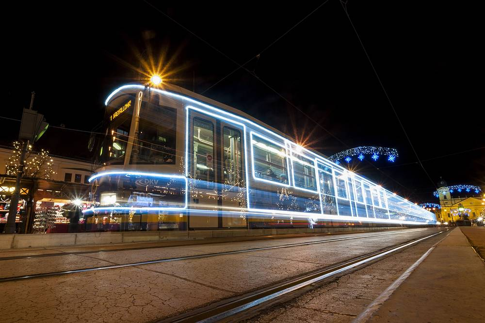 Photo: illuminated tram runs on Kossuth Square in Debrecen, Hungary