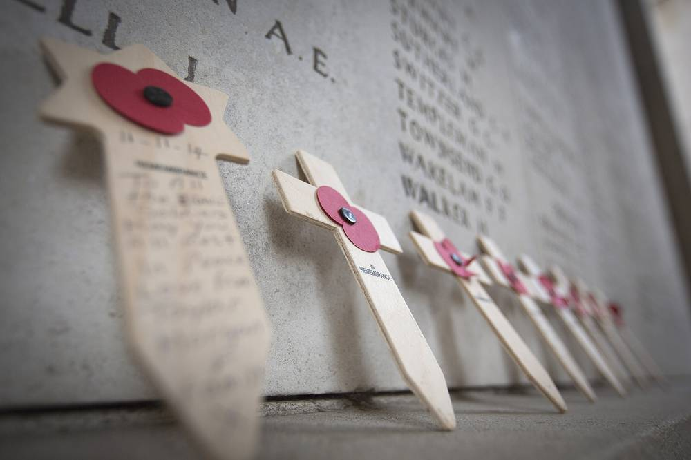 Photo: Wooden crosses with red poppies are left at the Menin Gate during an Armistice Day ceremony in Ypres, Belgium on November 11, 2014