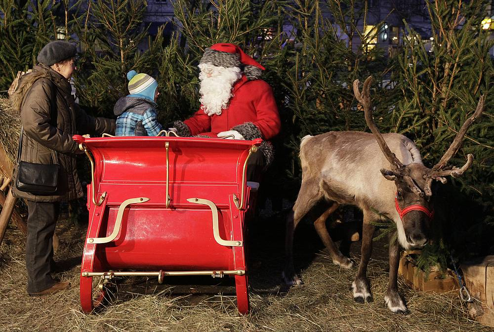 The Polish Santa is named Mikolaj, or St. Nicholas, and it is on his feast day that children receive presents. Photo: Santa Claus in Warsaw, Poland