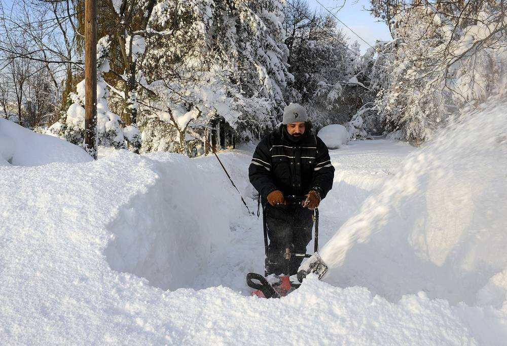 A ferocious storm dumped massive piles of snow on parts of upstate New York, trapping residents in their homes and stranding motorists on roadways
