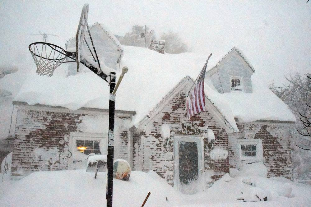 Photo: House covered in snow in a neighborhood south of Buffalo, New York