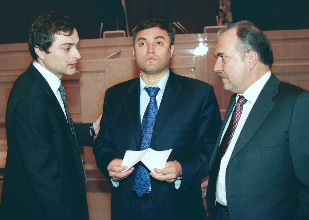 In 2003 Putin spoke about national security issues and improvement of living standards in Russia. Photo: Presidential chief of staff Vladislav Surkov talking to State Duma deputies Vyacheslav Volodin and Vladimir Pekhtin ahead of Putin's address to the parliament. May 16, 2003