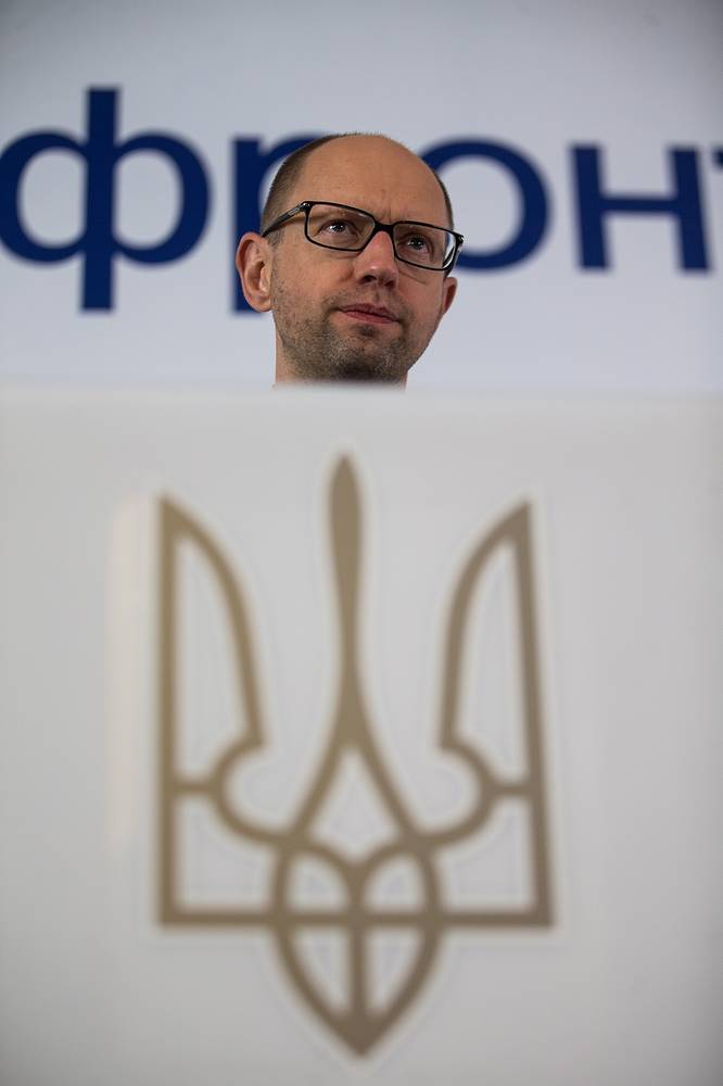 Ukrainian Prime Minister Arseny Yatsenyuk answers questions during a news conference on the results of parliamentary elections in Ukraine