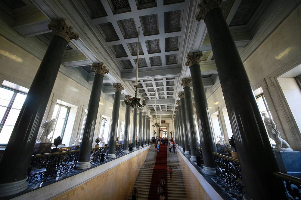 The collections occupy a large complex of six historic buildings along Palace Embankment, including the Winter Palace, a former residence of Russian emperors. Photo: Main staircase of New Hermitage