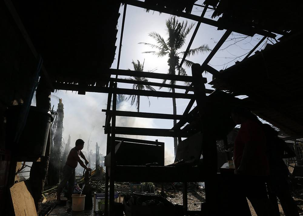 On December 8 typhoon Hagupit weakened into a storm.  Photo: A damaged house in a typhoon hit town, Samar island, Philippines, 08 December 2014