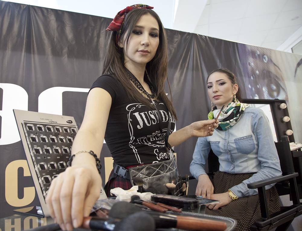 A model getting ready for a runway show at the 2014 Grozny Fashion Week