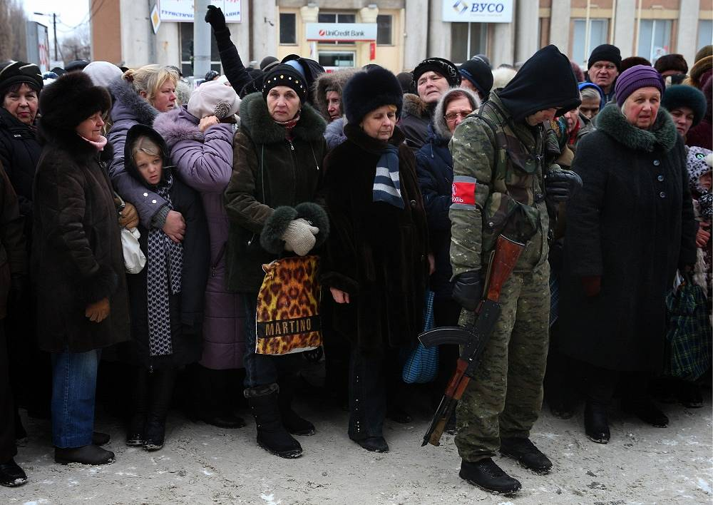 Photo: People queue at a market in the town of Makiivka where local producers sell their goods at a reduced price, Donetsk region