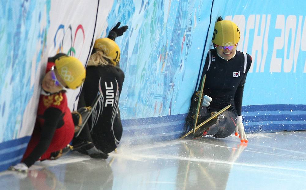 Female speed skaters during a 1,500m race at the Sochi Olympics