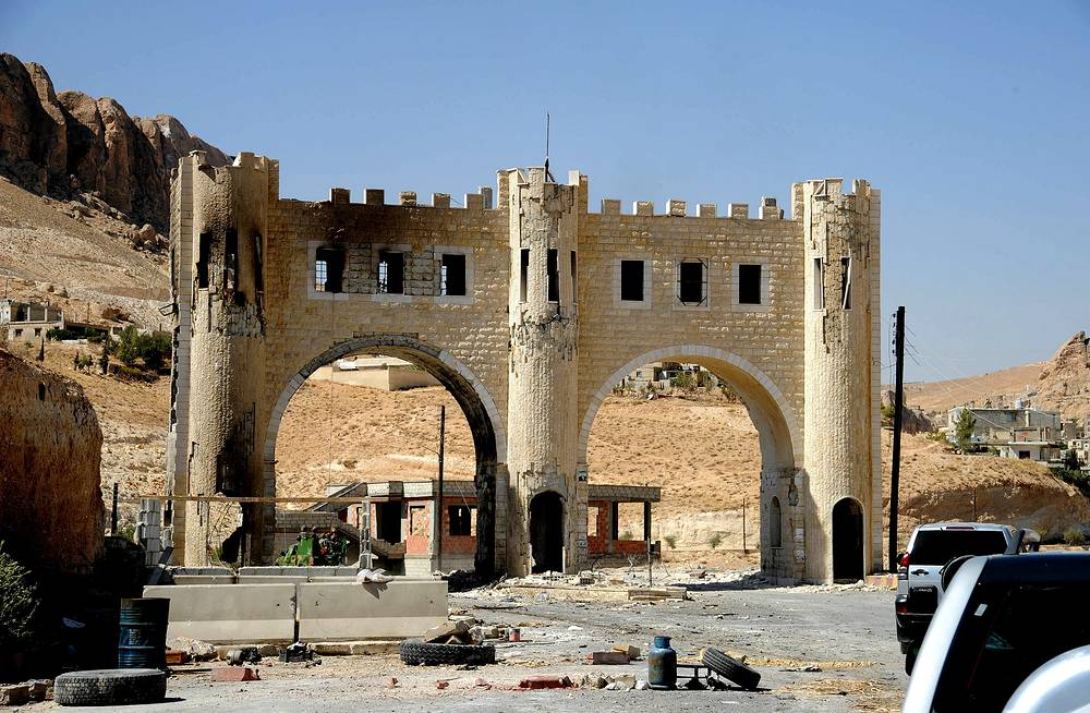 Damage at the entrance of Maaloula village, northeast of Damascus, Syria