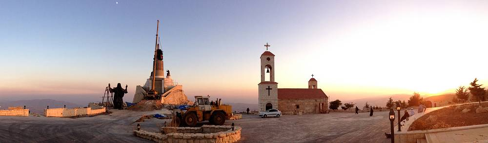 Workers preparing to install a statue of Jesus on Mount Sednaya, Syria. In the midst of a civil war rife with sectarianism, a 12.3-meter tall, bronze statue of Jesus has gone up on a Syrian mountain, apparently under cover of a truce among three factions - Syrian forces, rebels and gunmen in the Christian town of Sednaya