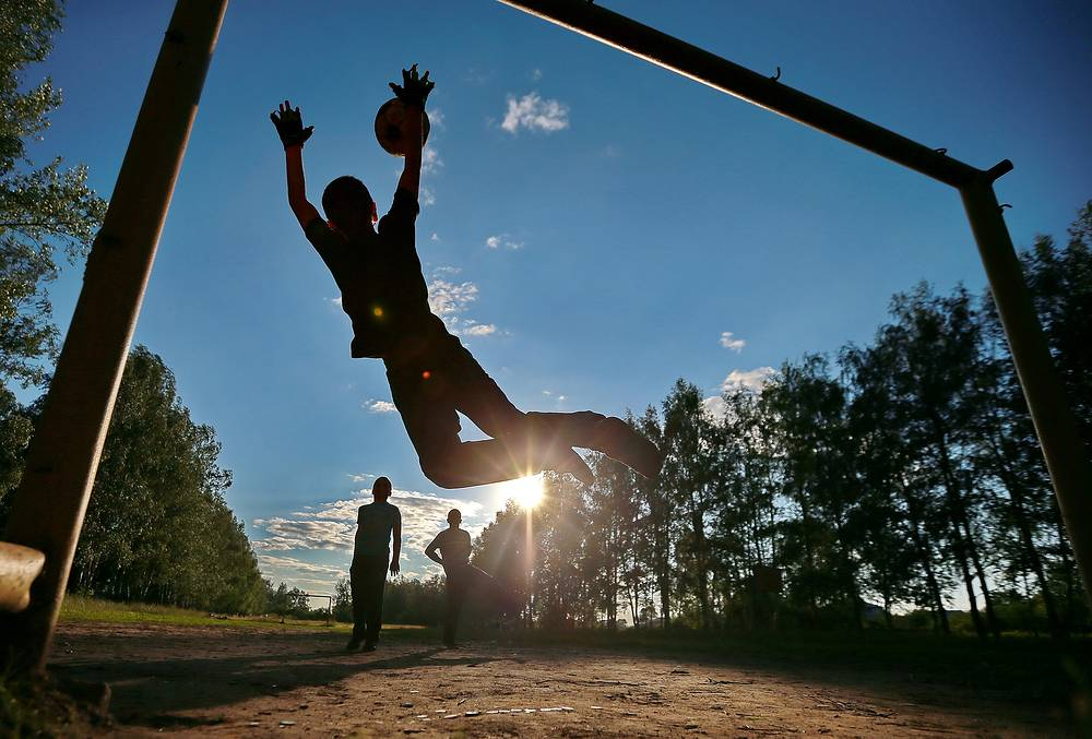 Children play football in a village in the Kostroma Region