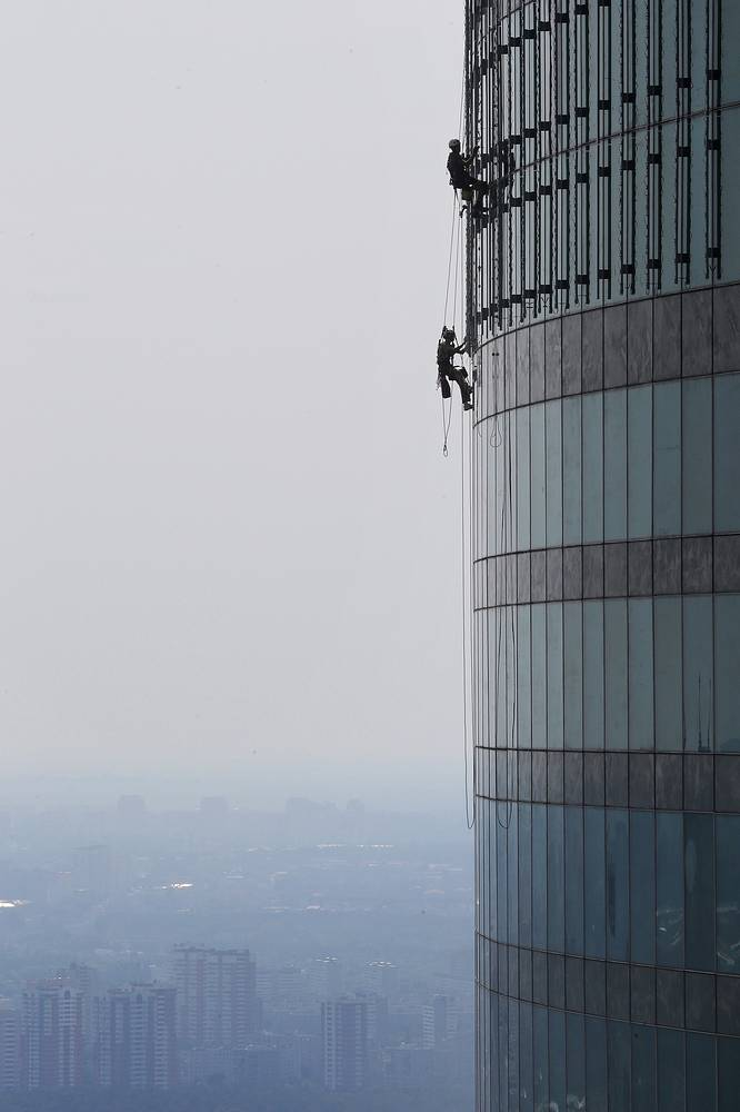 Industrial climbers work at the Moscow City business center