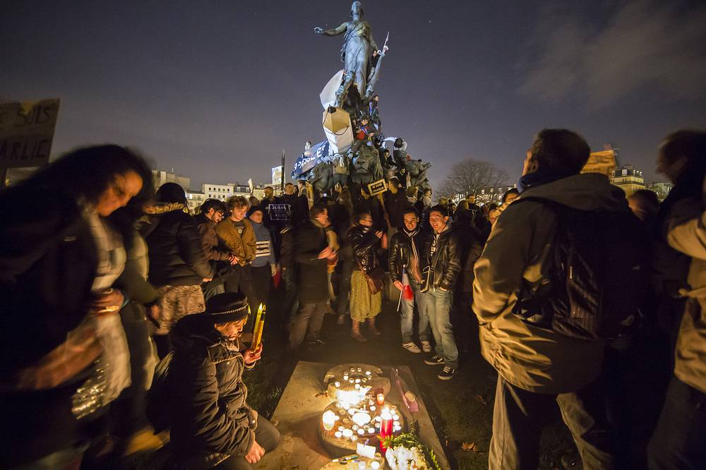 Photo: People near the monument on Place de la Nation as millions of people march against terrorism in Paris