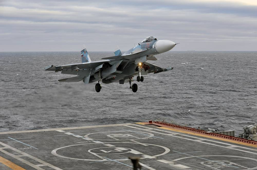 Su-33 multirole fighter jet approaching the deck of the Russian aircraft carrier Admiral Kuznetsov in the Barents Sea, 2010