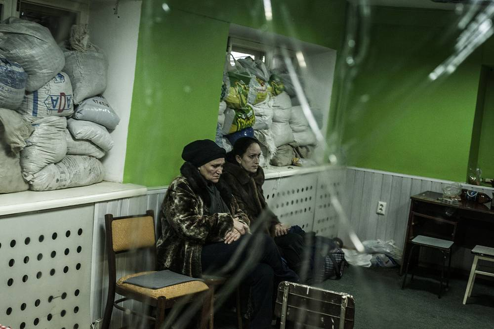 Photo: Women sit in a shelter during an exchange of artillery fire between DNR forces and the Ukrainian army in Donetsk