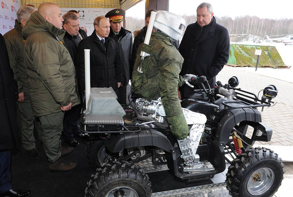 Russia's president Vladimir Putin and deputy prime minister Dmitry Rogozin in the Central Scientific Research Institute of Precise Mechanical  Building in Klimovsk, Moscow Region