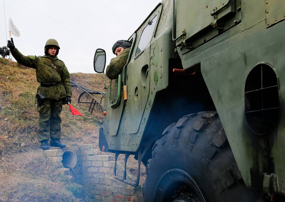 Operator of S-300 launcher vehicle making maneuvers