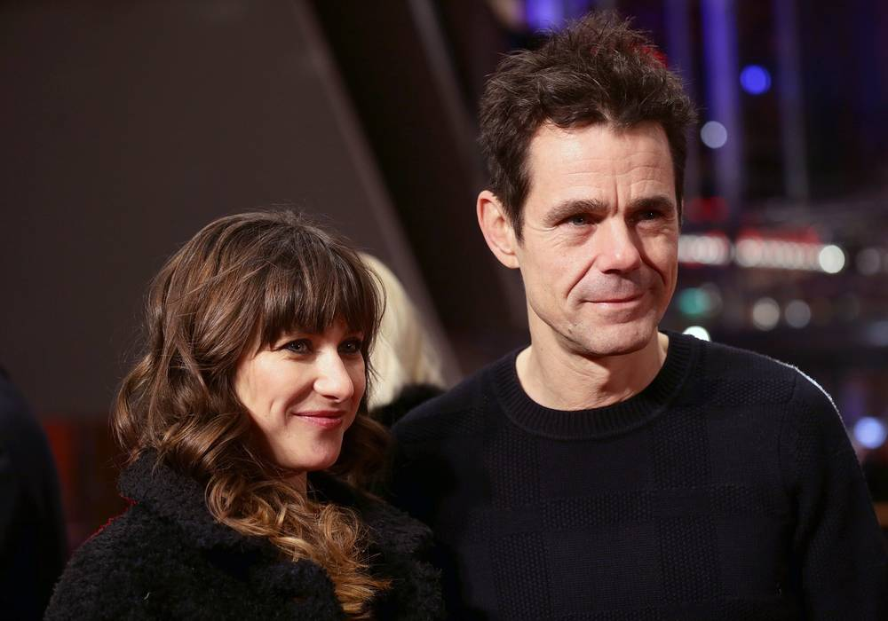 German director Tom Tykwer and his wife in Berlinale Palace