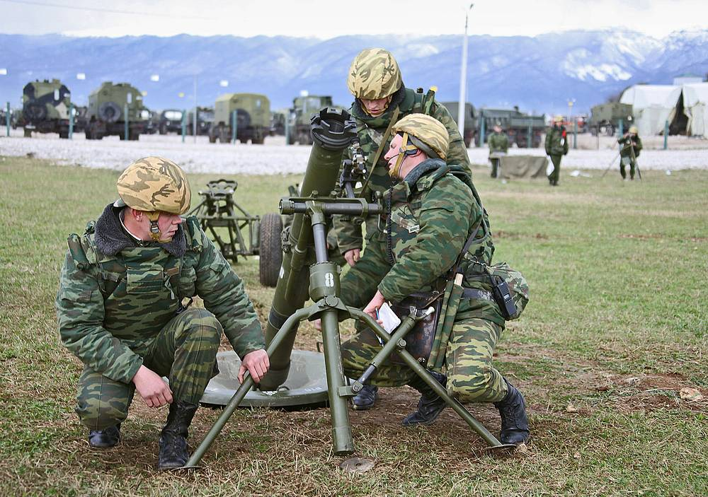Soldiers seen during a range practice at Russia's 7th military base in Gudauta, Abkhazia
