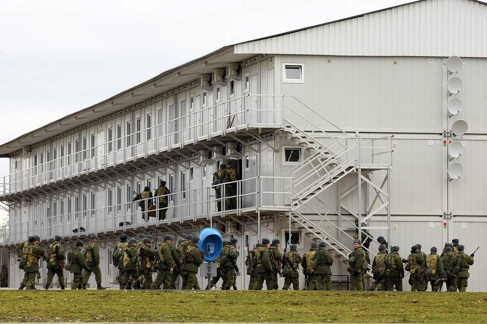 Servicemen seen outside military barracks at the 7th military base of Russian forces in Gudauta, Abkhazia
