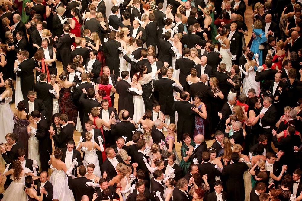 Dancers crowd the dance floor during traditional Opera Ball in Vienna, Austria