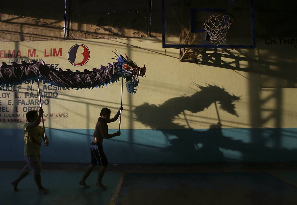 Filipino performers practice their dragon dance as they prepare for Chinese New Year celebrations in Manila, Philippines