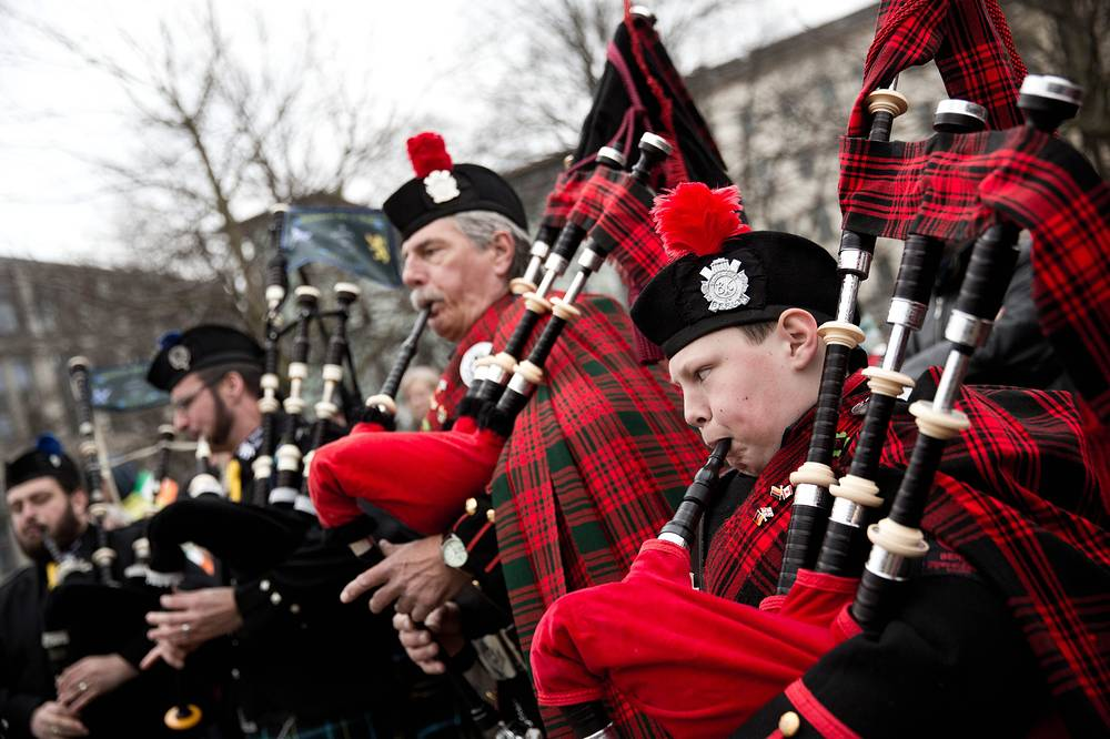 Backpipe players performing as hundreds of people participate in the St Patrick's Day parade in Berlin, Germany