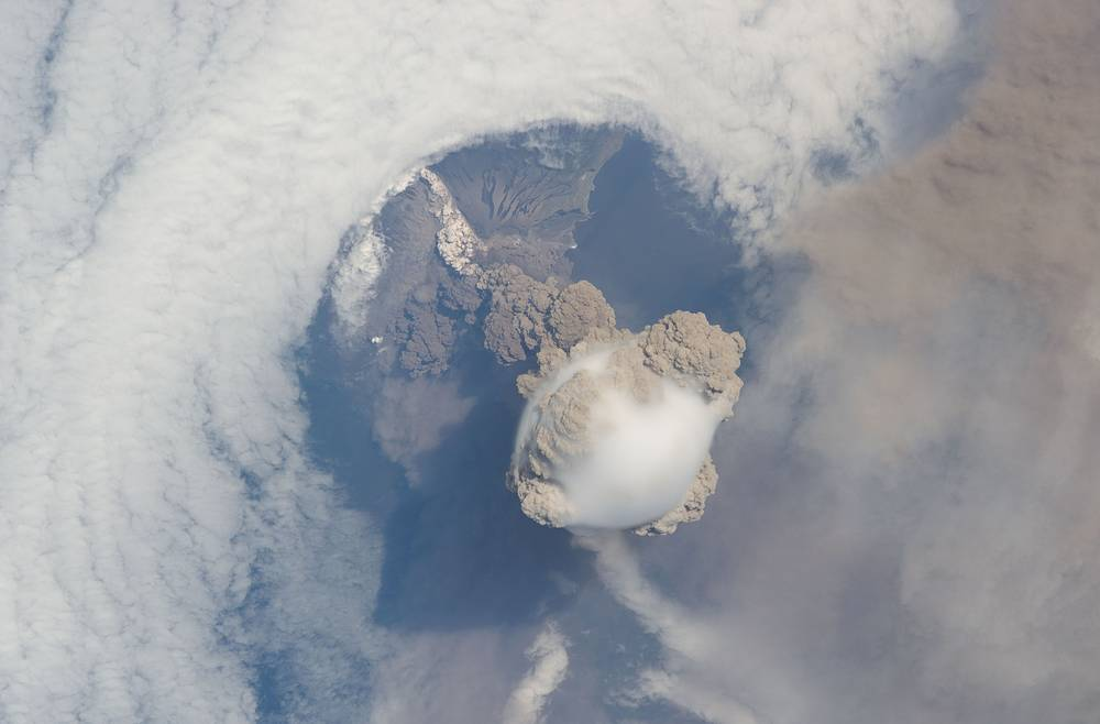 Sarychev volcano erupted on 12 June 2009.  Astronauts were able to photograph the event as the International Space Station passed overhead during the eruption. Photo: Sarychev volcano, in Russia's Kuril Islands, northeast of Japan, in an early stage of eruption on June 12, 2009