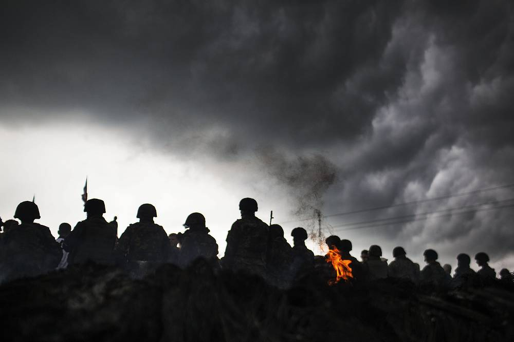 Ukrainian Army soldiers during a military operation against the militia the Andreevka village, Ukraine, May 2014
