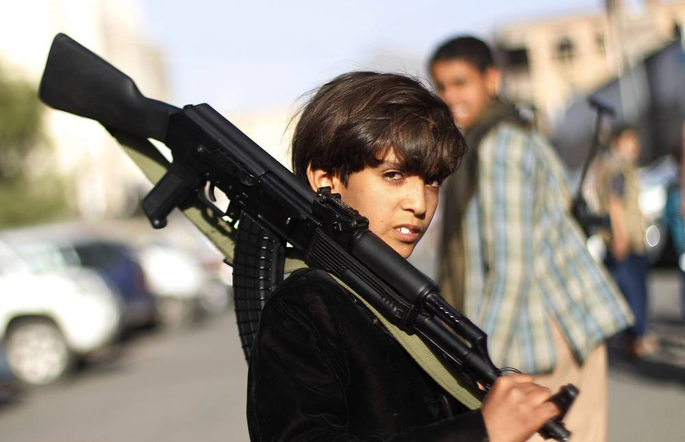 A Yemeni boy at demonstration against an arms embargo imposed by the UN Security Council on Houthi leaders, in Sanaa