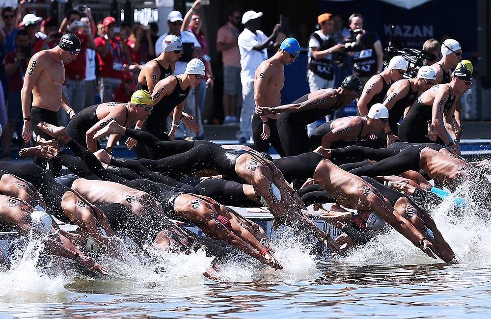 Athletes competing in the men's 10km open water final, July 27