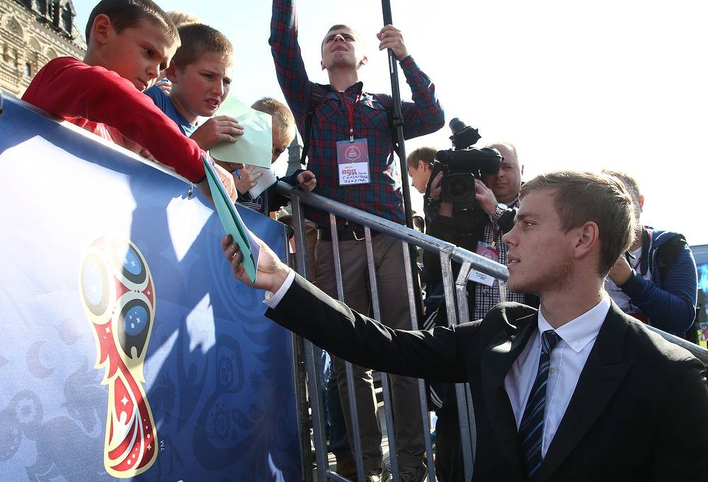 Alexander Koronin, member of the Russian national football team, signing autographs in Moscow's Red Square