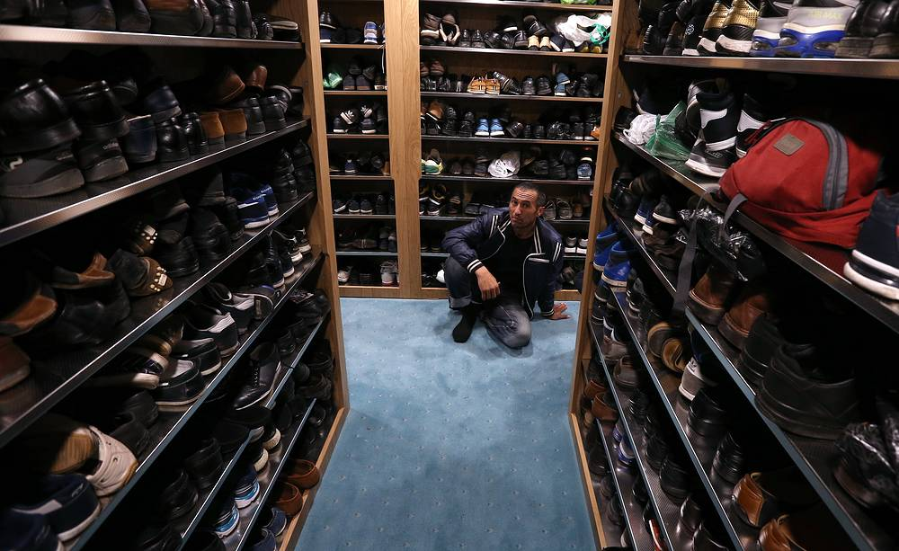 A Muslim seen by shoe racks inside the Moscow Cathedral Mosque