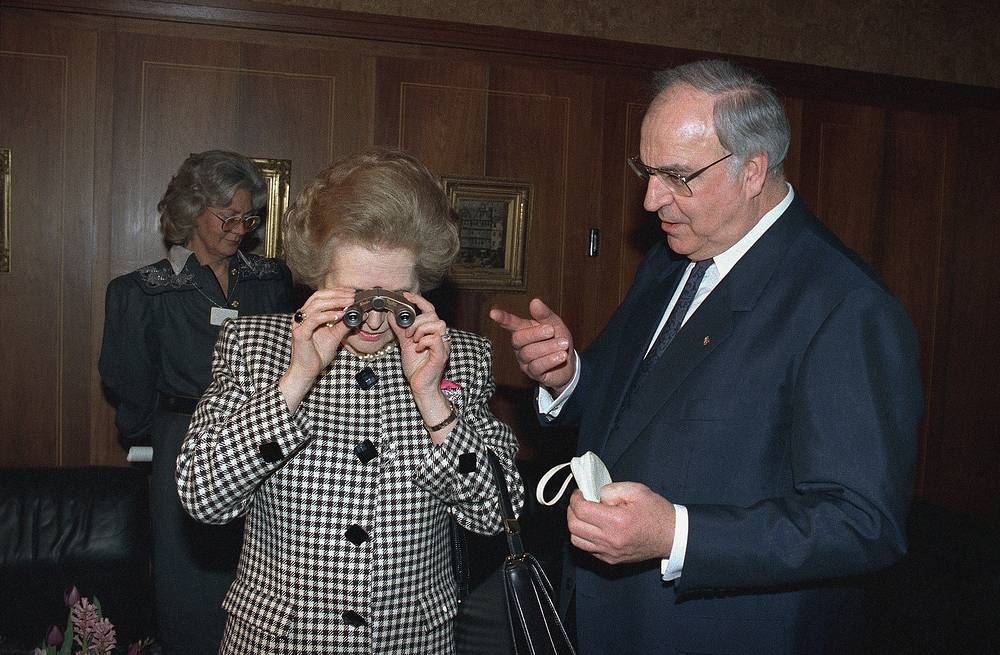 She retired from the House of Commons at the 1992 election, aged 66, saying that it would allow her more freedom to speak her mind. Photo: Margaret Thatcher viewing through an opera glass she was presented with by West German Chancellor Helmut Kohl, 1989