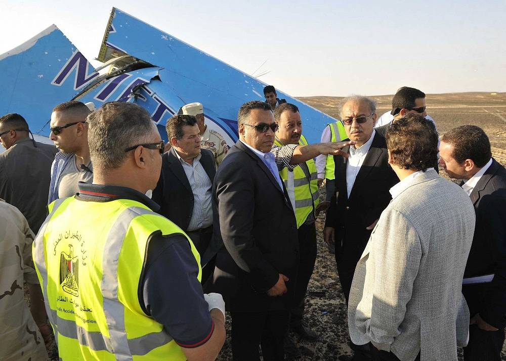 Sherif Ismail and military and government officials at the site where a passenger plane crashed in Hassana Egypt