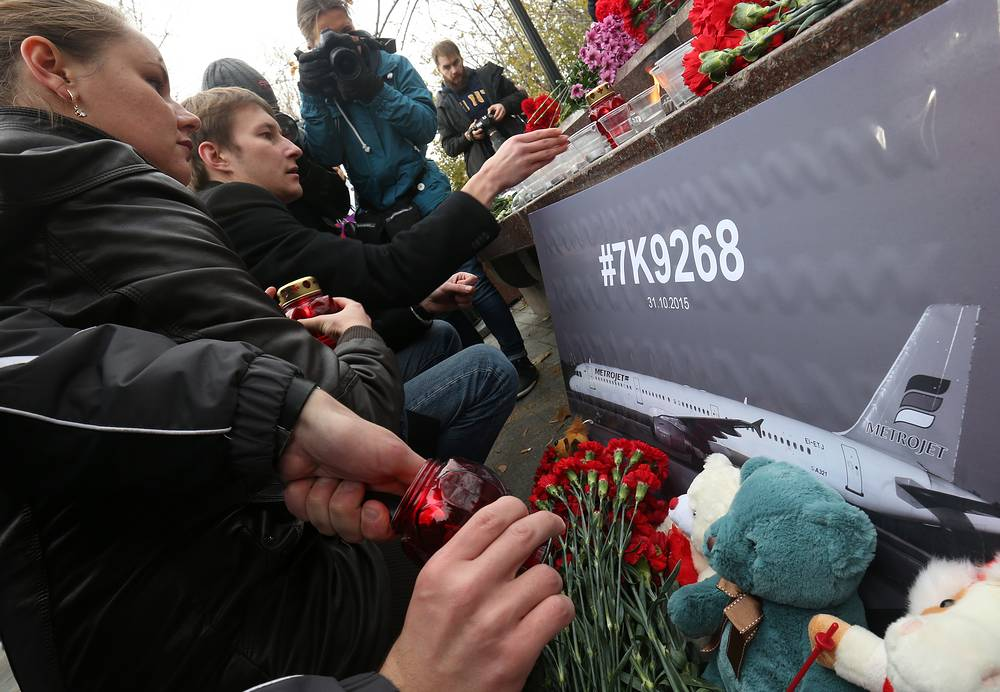 People with flowers and candles in Moscow, Russia