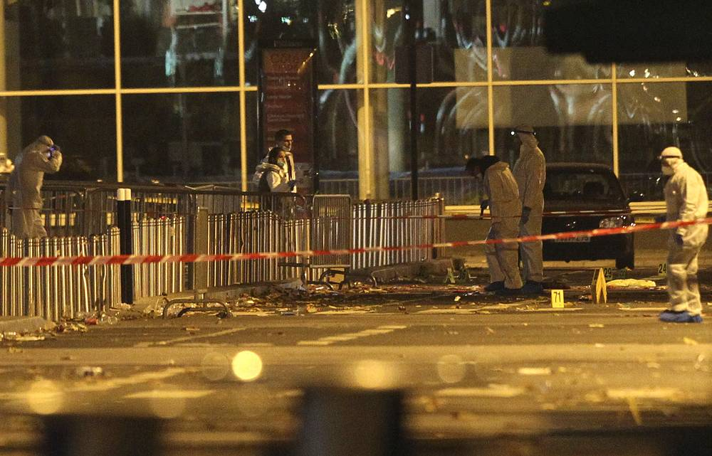 A series of terrorist acts took place at various venues in Paris on November 13. Photo: Investigating police officers working outside the Stade de France stadium after an explosion