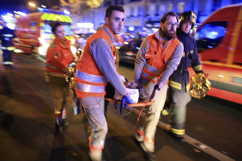 A woman being evacuated from the Bataclan theater