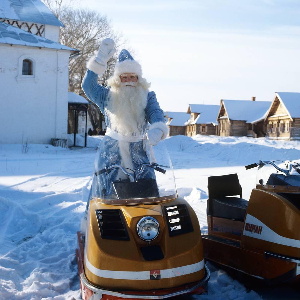 Grandfather Frost gets ready for a ride on a snowmobile, Suzdal, Vladimir region, 1983