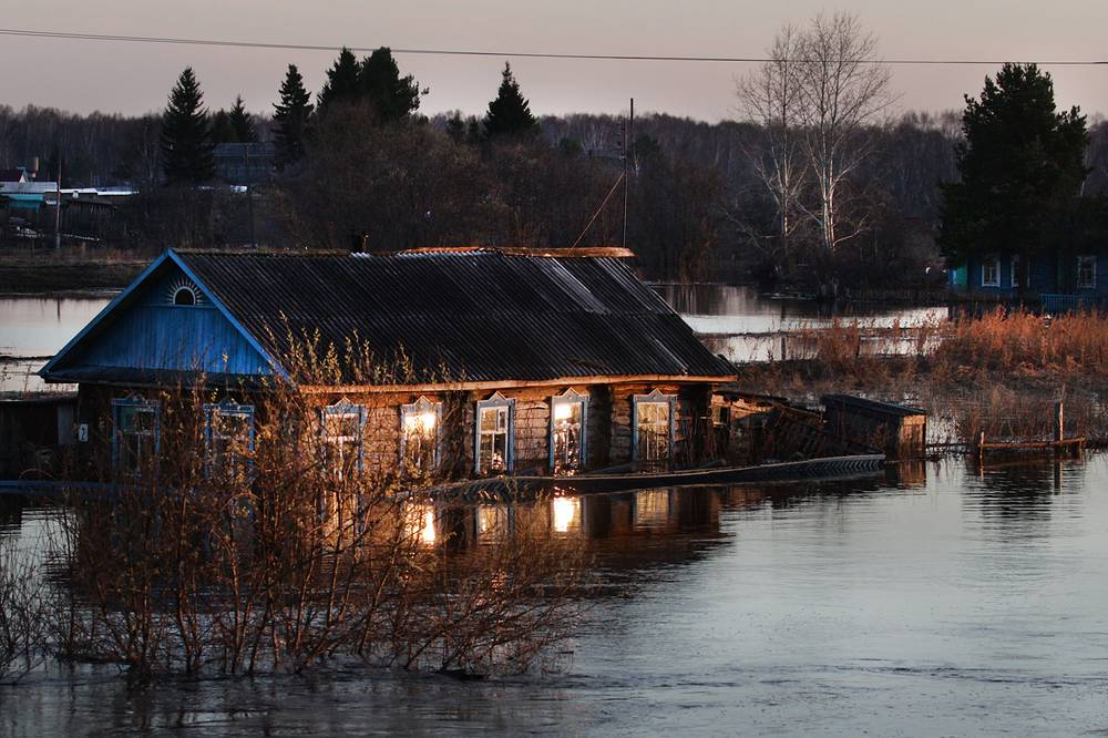 The River Ayov breaks its banks and causes a flood in Bolshie Uki village, Omsk region, April 23