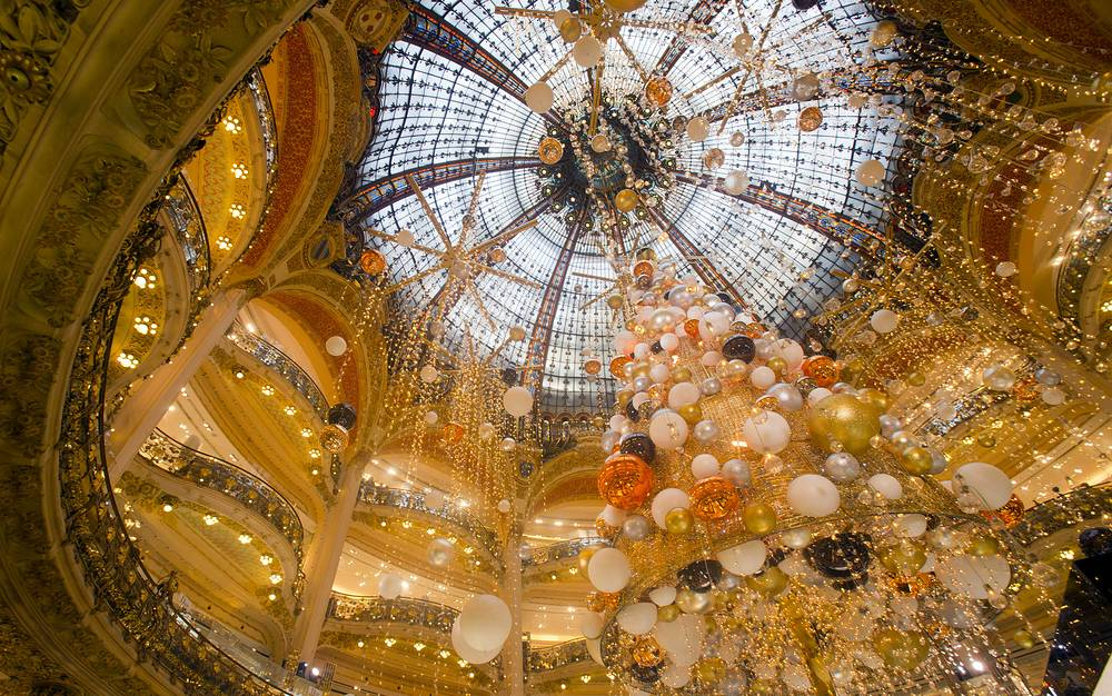 Christmas tree erected at the center of a Paris department store, France