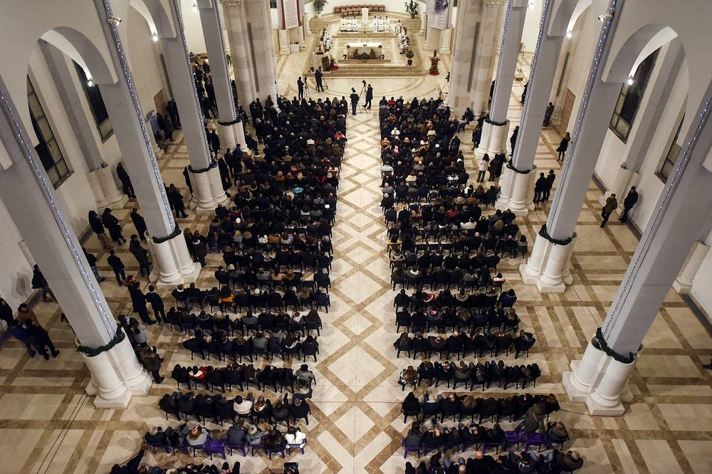 Kosovo Christians attending the Christmas Eve Mass in Mother Teresa Cathedral in Kosovo capital Pristina