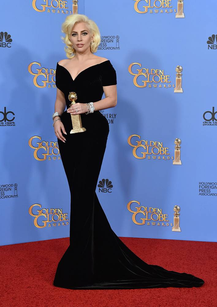 "Lady Gaga in the press room with the award for best performance by an actress in a limited series or a motion picture made for TV for ""American Horror Story: Hotel"""