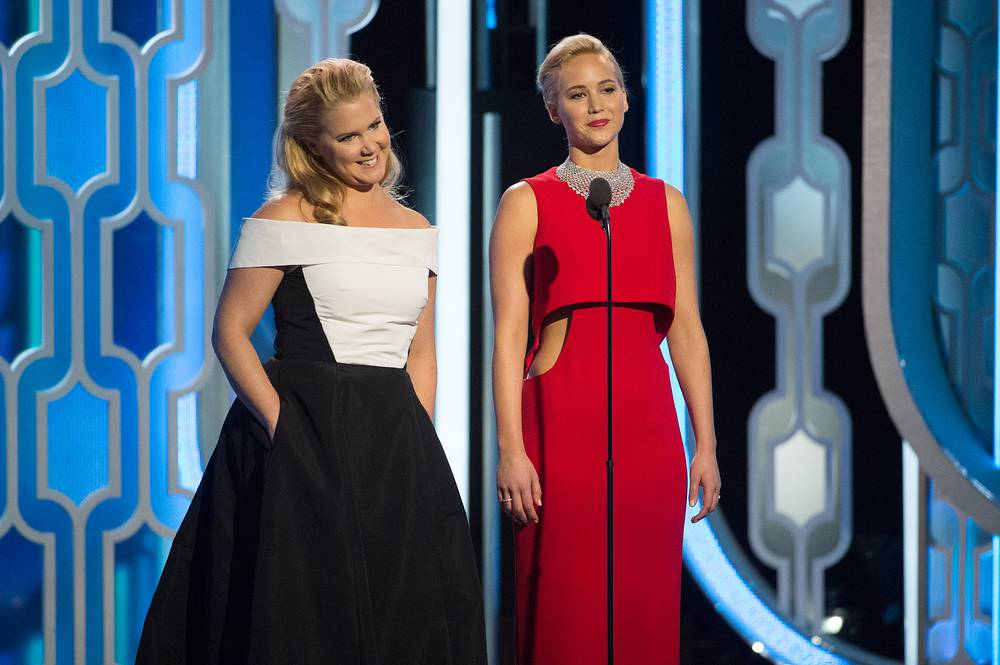 """Jennifer Lawrence (right) onstage at the 73rd Annual Golden Globe Awards as she received the award for best performance by an actress in a motion picture - musical or comedy for """"Joy"""""""
