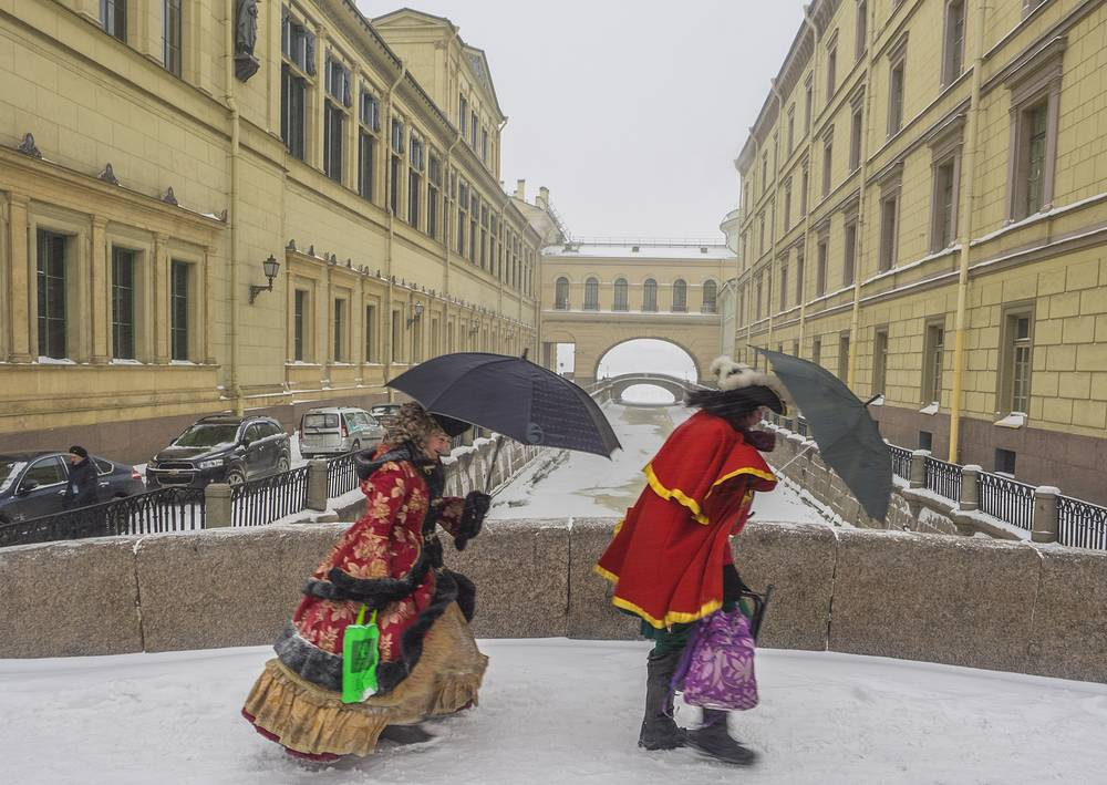 People dressed as Peter the Great and Catherine the Great walking near the Winter Canal in Saint Petersburg